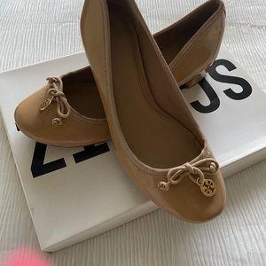 Tan heeled flats